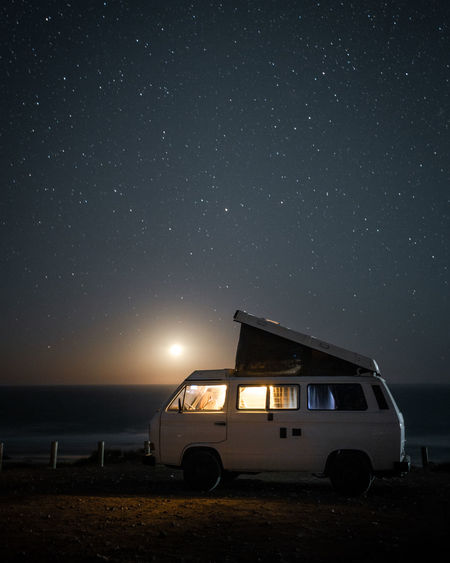 Volkswagen T3 Westfalia camper van under a starry sky on a clear night in Fuerteventura and the setting moon in the background. Night Mode Of Transportation Sky Transportation Land Vehicle Car Nature Motor Vehicle Illuminated No People Star - Space Land Scenics - Nature Beauty In Nature Astronomy Outdoors Space Motor Home Stationary Beach Vanlife Vanlifers Vanlifediaries Vanlifeexplorers Vanliving Camper Campervan Camper Van Travel Travel Destinations Traveling Travel Photography Travelling Moon Moonlight Starry Starry Sky Stars Moon Shots Long Exposure Vwbulli Volkswagen VwT3 Vintage Vintage Car Nature Nature_collection Nature Photography Summer Camping