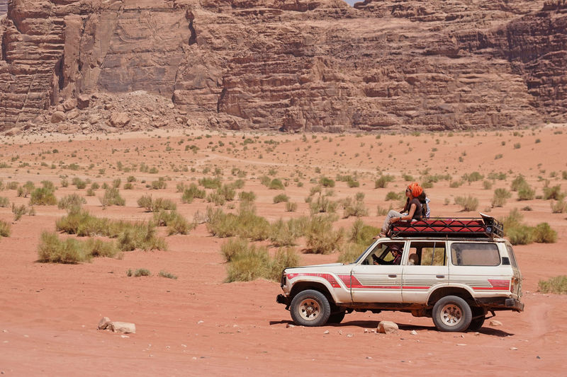 4x4 Wadi Rum Adult Adults Only Adventure Arid Climate Day Desert Driving Journey Land Vehicle Landscape Men Mode Of Transport Nature Off-road Vehicle Outdoors People Real People Road Scenics Togetherness Transportation Travel Travel Destinations