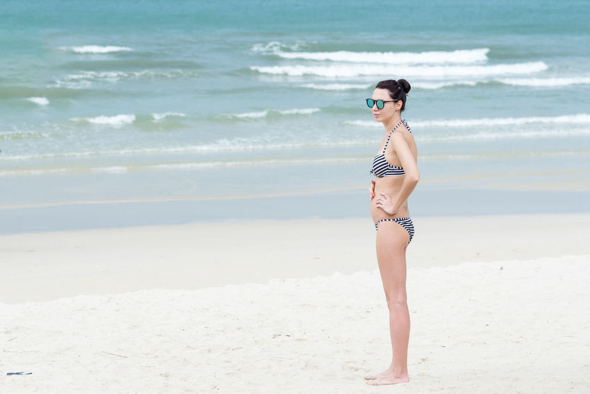 Trat, Thailand - May, 20, 2017 : Unidentified name woman wear a swimsuit bikini standing on the Prao Beach in Koh Chang island Trat, Thailand. Beach Beautiful Woman Beauty Beauty In Nature Day Editorial  Full Length Horizon Over Water Illustrative Illustrative Editorial Leisure Activity Nature One Person Outdoors Real People Sand Sea Shore Standing Thailand Vacations Water Wave Young Adult Young Women
