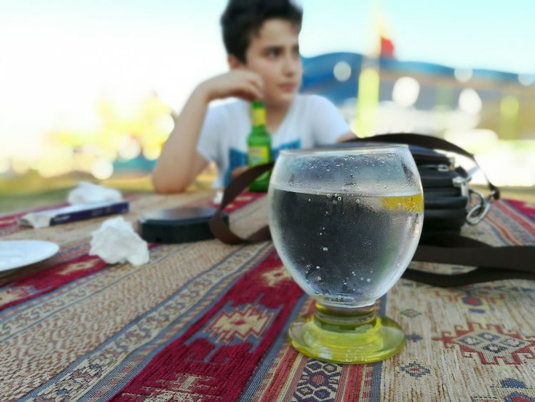 EyeEmNewHere Food And Drink Table Drinking Glass Freshness People Outdoors Drink One Person Bokeh Photography Bokeh Effect Bokeh Dual Camera Dual Lens Soda Fresh Soda Beatiful place from İğneada turkey and drink