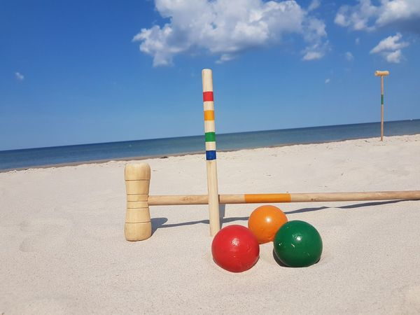 fun on the beach Croquet Fun EyeEm Selects Water Sea Beach Sand Summer Buoy Blue Sky Horizon Over Water Cloud - Sky
