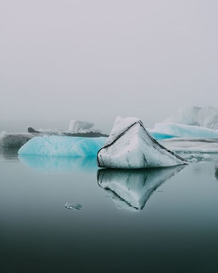 EyeEm Selects Cold Temperature Ice Beauty In Nature Water Glacier Frozen Winter Lake Nature Scenics Floating On Water Tranquil Scene Tranquility No People Iceberg - Ice Formation Snow Outdoors Day Iceberg Travel Destinations Iceland Travel Foggy Moody The Week On EyeEm Fresh On Market 2017