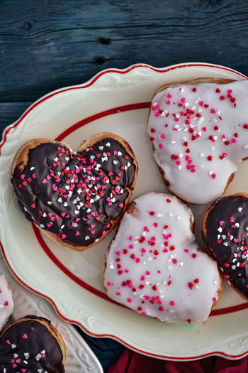 Valentines day chocolate and vanilla heart donuts with colorful tiny heart sprinkles