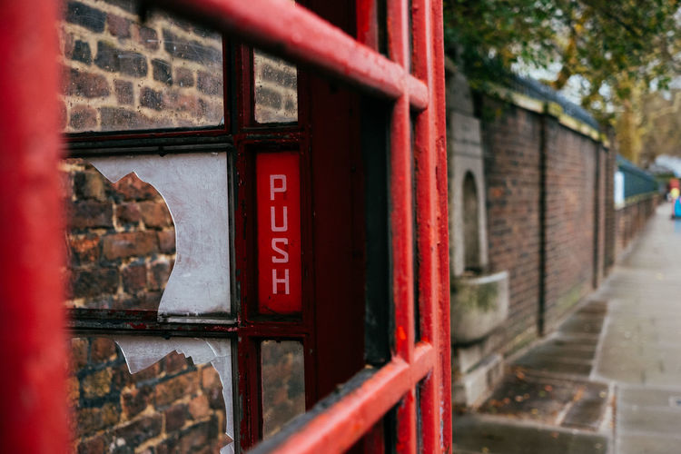 Way too hard! Fujifilm_xseries Streetphotography London Red Architecture Built Structure Day No People Focus On Foreground Building Exterior Building Telephone Booth Outdoors Communication Text Metal Nature Security Protection Close-up Place Of Worship Selective Focus Window
