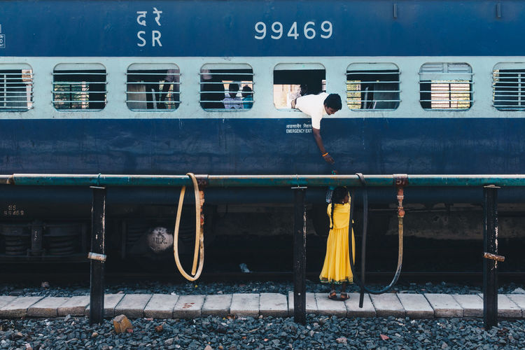 Transportation Mode Of Transportation Rail Transportation Public Transportation Train Train - Vehicle Track Day Architecture Railroad Track Men Outdoors Travel Land Vehicle Real People Window Railroad Station People Railroad Station Platform Rear View India Streetwise Photography The Art Of Street Photography The Traveler - 2019 EyeEm Awards The Street Photographer - 2019 EyeEm Awards