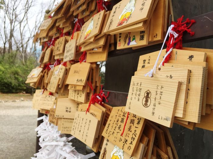 Wishes tied to nails on wooden plank