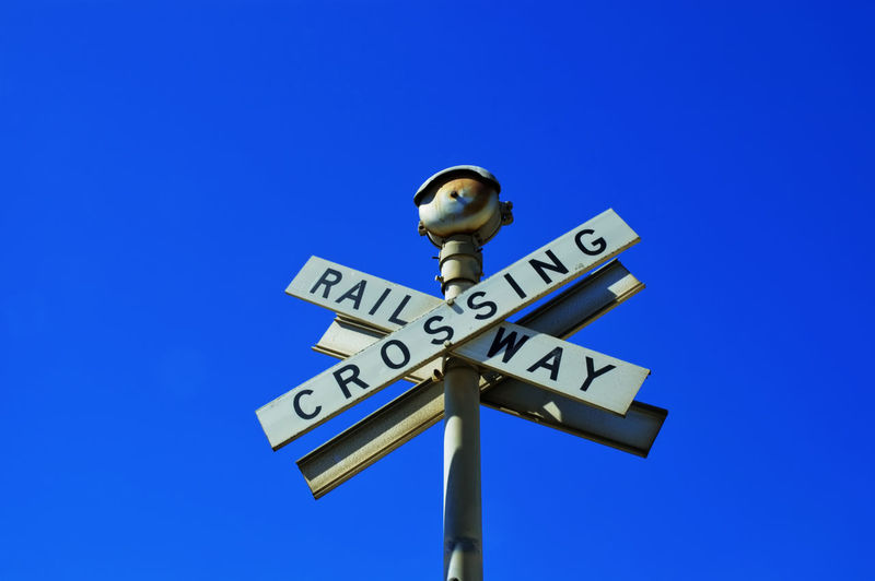 "Western Australia, Perth, Fremantle, Old ""Railway Crossing"" sign 'Railway Crossing' Sign Australia Blue Clear Sky Close-up Color Image Day Fremantle, Western Australia Horizontal Nature No People Old Outdoors Perth Photo Road Sign Sky Transportation"