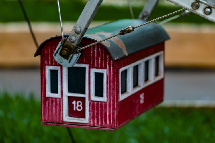 Focus On Foreground Hanging Red Close-up Day Text No People Selective Focus Western Script Communication Outdoors Mode Of Transportation Number Transportation Retro Styled Nature Wood - Material Toy Land Vehicle Minimundus
