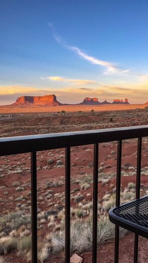 Las Vegas Documentary Photography Monument Valley Tribal Park Monument Valley Park Arizona Visiting Monument Valley Monument Valley Sky Architecture Built Structure Sunset Nature Cloud - Sky Railing Day Outdoors Mountain No People Tranquil Scene Security Metal Orange Color Scenics - Nature Water Sunlight Safety Protection