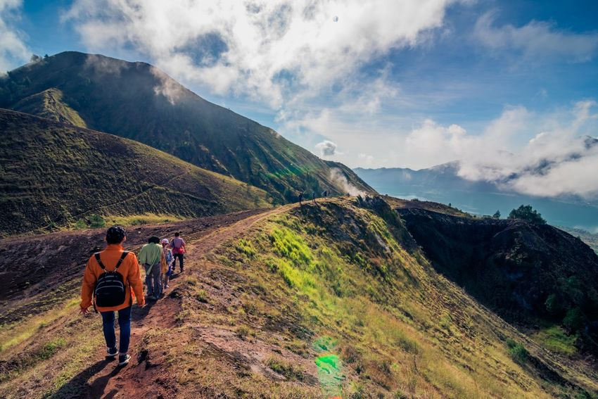 Hiker on Batur Volcano, Indonesia Bali Batur Freedom Hiking Nature Tourist Adventure Backpack Beauty In Nature Cloud - Sky Day Exploration Group Of People Hiker Hiking Landsacpe Landscape Leisure Activity Lifestyles Men Mountain Mountain Range Nature Outdoors Real People Rear View Scenics Sky Togetherness Tourism Tranquil Scene Tranquility Two People Volcano Walking