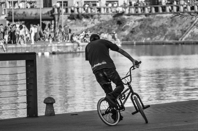 Adult Architecture Bicycle Built Structure Competitive Sport Day Full Length Leisure Activity Lifestyles Men One Person Outdoors People Real People Rear View Water