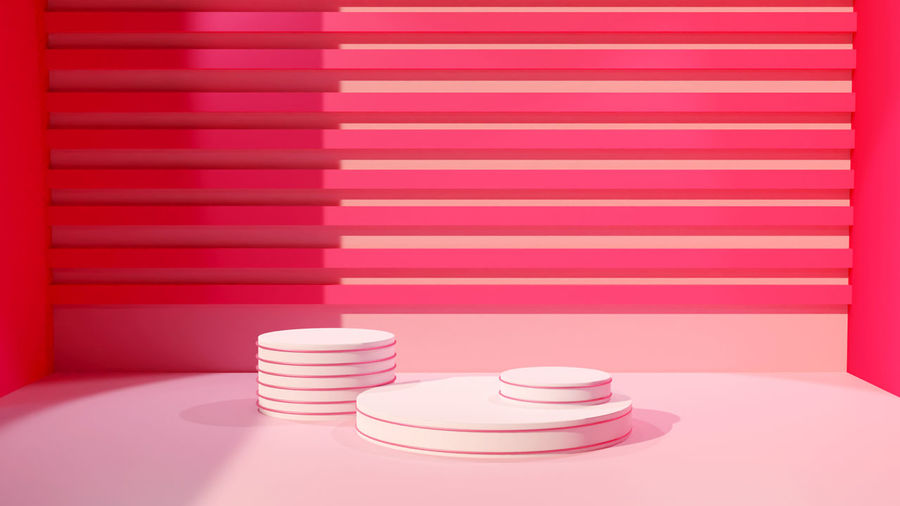 Close-up of pink stack on table against wall at home