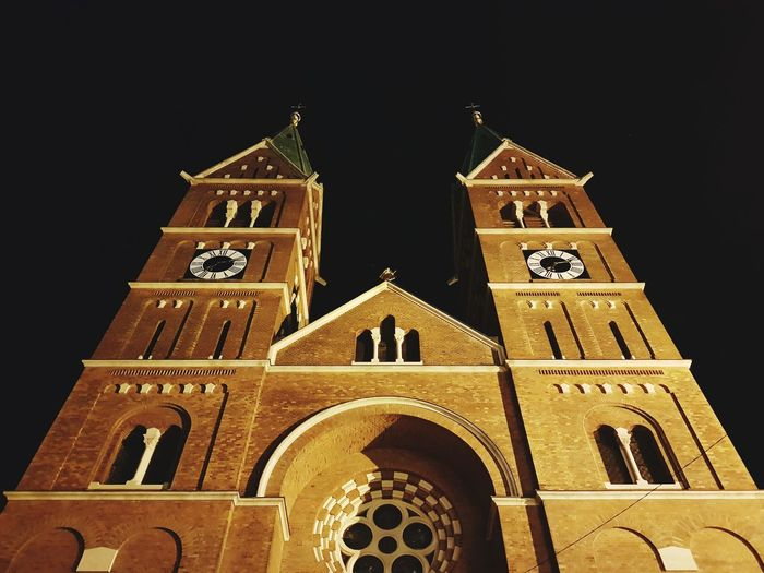 Low angle view of bell tower at night