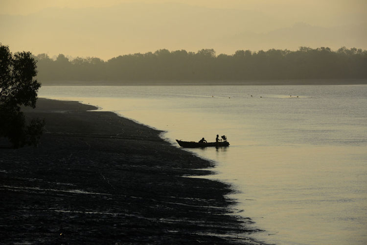 TWO REMOTE PEOPLE LEAVING BY BOAT