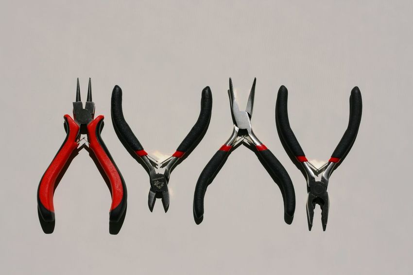 """Those are my """"designer"""" tools. When I am not taking photos, I am making bisuteria. Arrangement Close-up Group Of Objects In A Row Instruments Large Group Of Objects Metal Tools On The Table Pliers Red And Black Studio Shot Tools Working Tools The Mix Up"""