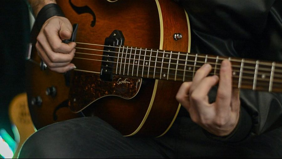Music Musical Instrument String Instrument Guitar Playing Musical Equipment Arts Culture And Entertainment Musician One Person Plucking An Instrument Artist Midsection Musical Instrument String String Human Hand Men Guitarist Skill  Hand Electric Guitar
