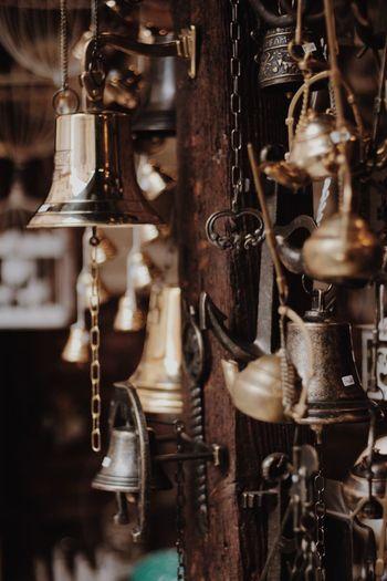 Close-up of bells hanging at market