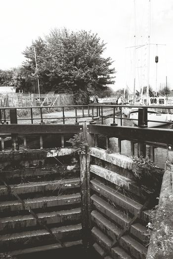 a weathered canal lock gate Blackandwhite EyeEm Selects Mersey River Mooring Cannel Locks Water Weathered Lock Gates Beauty Waterfront Peaceful Outdoors Old Greenery Landscape Premium Worn Out Historic Boat Bridge