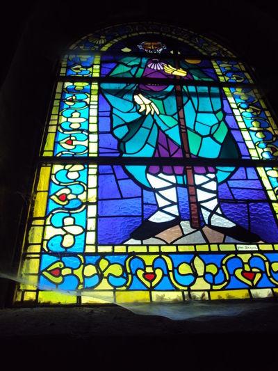 Multi colored glass window in building