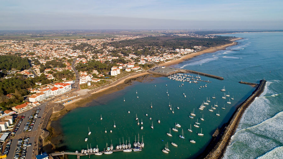 Aerial photography of Jard sur Mer village in Vendée, France Jard Sur Mer Vendée France City Cityscape Village Town Atlantic Ocean Sea Water Coastline Coast Port Marina Bay Harbor Aerial View Aerial Photography Landscape Boat Wave Sky Outdoors Nature Day