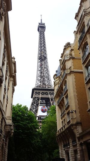 Eiffel Tower with Football. EM 2016 Travel Destinations Architecture Travel Tower Built Structure City Outdoors Day Building Exterior No People Sky Tree Paris France Eiffel Tower Tour Eiffel Tourism Travel History Vacations Eifelturm Architecture Stadtansichten Fussball Ball