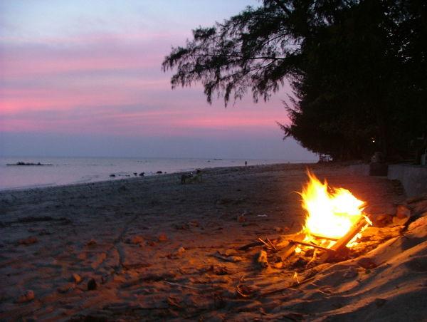 Beach Bonfire Bonfire On The Beach Evening Fire Firelight Horizon Over Water Idyllic Sand Scenics Sea Shore Silhouette.. Sky Sun Sunset Tranquil Scene Water