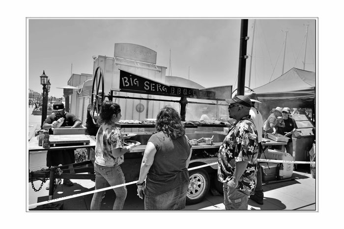 Hanging Out At Jack London Square 4 Port Of Oakland, Ca. Jack London Square Bnw_friday_eyeemchallenge Bnw_street BBQ Rib Rack Men Barbecuing Barbecue Smoke Grill Grilling Ribs People Watching Woman Serving Monochrome_Photography Monochrome Black & White Photography Black & White Black And White Collection  Black And White Bnw_streetphotography Urban Photography Farmers Market Lamposts