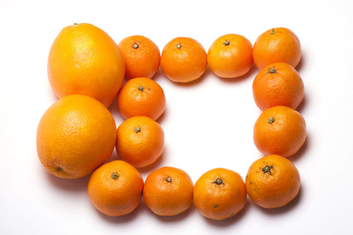 frame of tangerines and oranges on a white background with space for text Be. Ready. New Year Sale Top Win Canon Canonphotography Citrus Fruit Close-up Cristmas Day Food Food And Drink Freshness Fruit Healthy Eating Healthy Lifestyle M5 No People Orange - Fruit Orange Color People, Closeup, Studio Shot Top View White Background