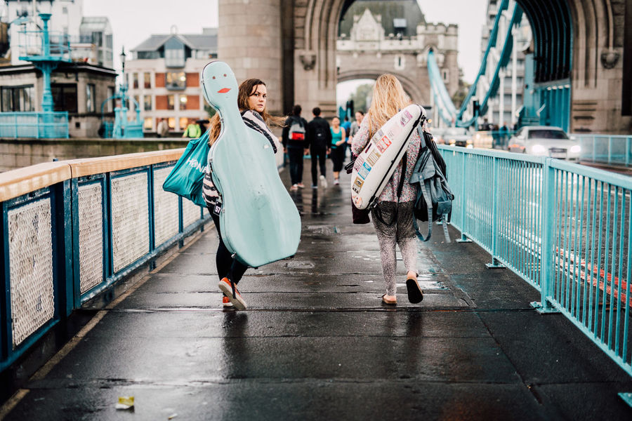 City Life Look Me In The Eyes Looking Back Musical Instruments Musician People Watching Peoplephotography Real People Street Streetphotography Tower Bridge  Women Music Brings Us Together TakeoverMusic