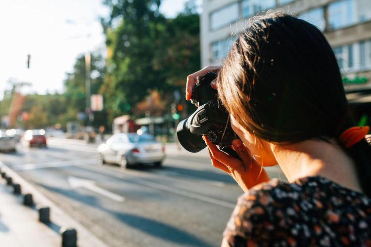 Woman photographer shots on streets of Sarajevo One Person Women City Transportation Real People Headshot Lifestyles Portrait Car Day Leisure Activity Outdoors Photographer Woman Photographer Streetphotography Autumn Golden Hour Sarajevo Bosnia And Herzegovina Camera Looking At Camera Photographing Sillouette Tourist Travel