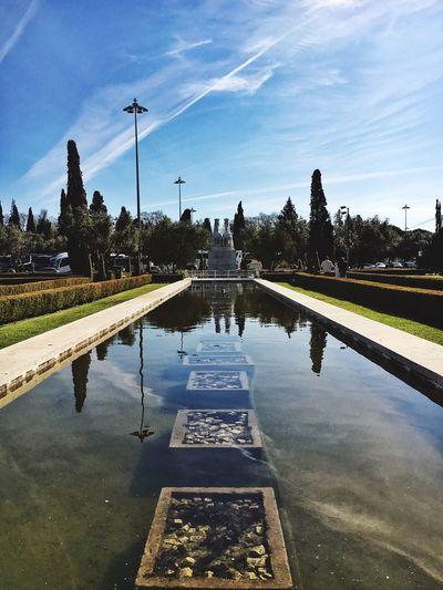 Pond At Jardins De Belem Against Sky On Sunny Day