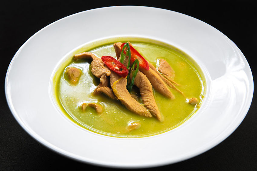 Chicken with green curry Asian  Asian Cuisine Chicken Dinner Dinner Time Spicy Appetite Appetizing Food Black Background Close-up Food Green Curry Chicken Healthy Eating Main Course Meat No People Nobody Plate Portion Ready-to-eat Restaurant Serving Dish Soup Thai Food Traditional