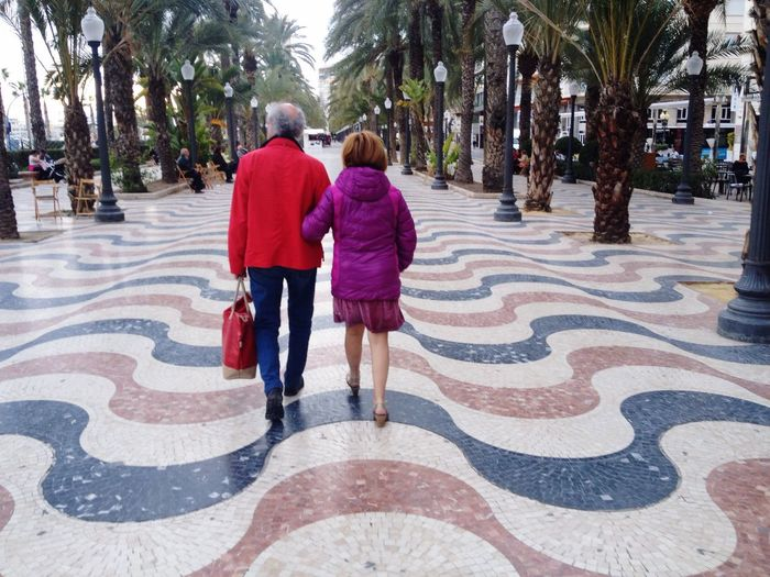 Still in love Rear View Two People Togetherness Senior Adult Warm Clothing Couple Old Couple Love Old Love Eternal Love Old Man Old Woman Explanada Explanada De España Alicante Pattern