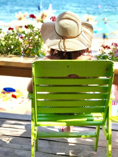 Hat Sun Hat Summer Outdoors Day Nature Sunlight Beauty In Nature Flower Growth Tree Woman One Woman Only Relaxing Vacations Hat Straw Hat Beach Sea Grass Close-up Freshness