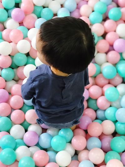 High angle view of baby boy playing with balls