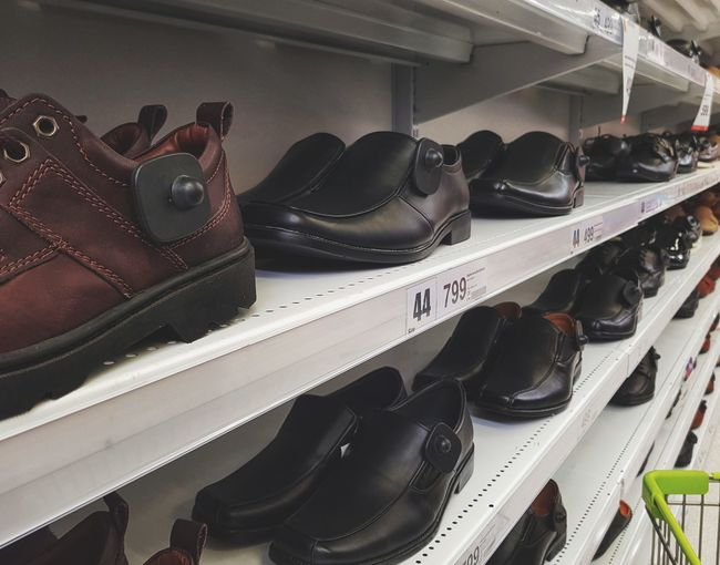Shelf Fashion Shoe Pair Business Finance And Industry Dress Shoe Variation Choice Shoemaker Store Things That Go Together Menswear Boutique Bridal Shop Department Store Trying On Fitting Room Dressmaker's Model Shoelace Shoe Store Footwear Flat Shoe Boot Canvas Shoe