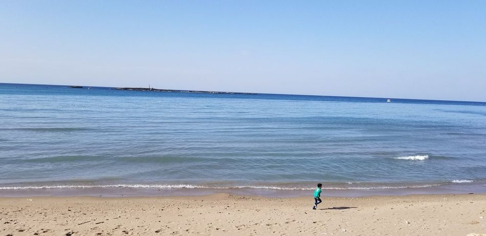 A child running on the beach Innocent shot🏃🏖️😇🌊🇱🇧⛱️🌴🏃 Child Running On Beach Water Wave Sea Beach Sand Full Length Summer Sky Horizon Over Water Tide Sand Pail And Shovel Shore Coast Sandcastle Rushing Coastline