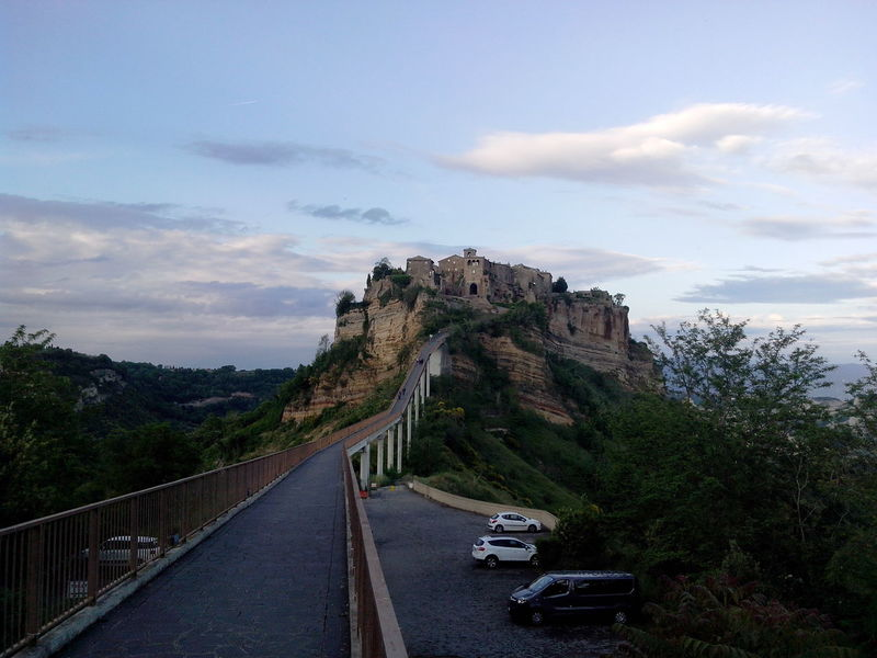 Ancient Architecture Beauty In Nature Bridge - Man Made Structure Civita Di Bagnoregio Cloud - Sky Diminishing Perspective Landscape Mode Of Transport Mountain Narrow Path On Top Of A Mountain Pavement Rock Formation Scenics The Architect - 2016 EyeEm Awards The City That Is Dying The Way Forward Travel Destinations Tuff Tufo Vanishing Point World Monuments Watch