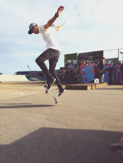 Young Adult Full Length Motion Leisure Activity Mid-air Skill  Young Men Only Men Skateboard Jumping Sport Casual Clothing One Man Only Adults Only People Men Adult One Person Practicing Recreational Pursuit