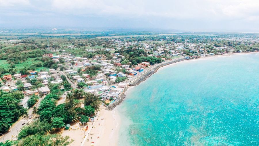 Sky Sea Beach Water Day Outdoors Nature Beauty In Nature High Angle View Scenics Cloud - Sky Architecture No People Aerial View Drone Photography Building Exterior Aerial Photography Puerto Rico Tranquility Tree Built Structure Horizon Over Water Cityscape
