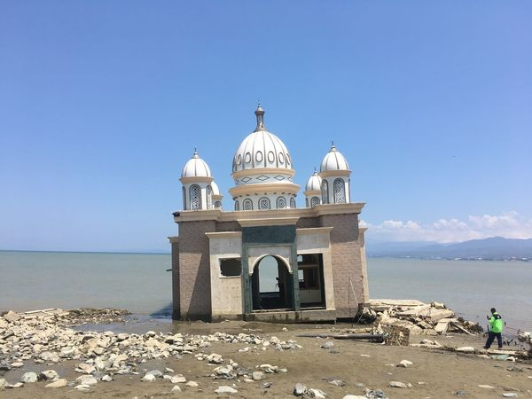 Apung Mosque Aftermath Earthquake Aftermath Sea Water Architecture Sky Built Structure Nature Beach Land Day Horizon Building Exterior Scenics - Nature Horizon Over Water Sunlight Outdoors Dome Incidental People Blue Clear Sky Beauty In Nature
