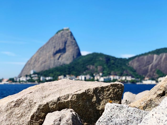 Flamengo Rio De Janeiro Water Rock Sea Rock - Object Sky Solid Nature Beauty In Nature Sunlight Tranquility Day Beach Land Rock Formation Scenics - Nature Clear Sky Blue Tranquil Scene Mountain Outdoors