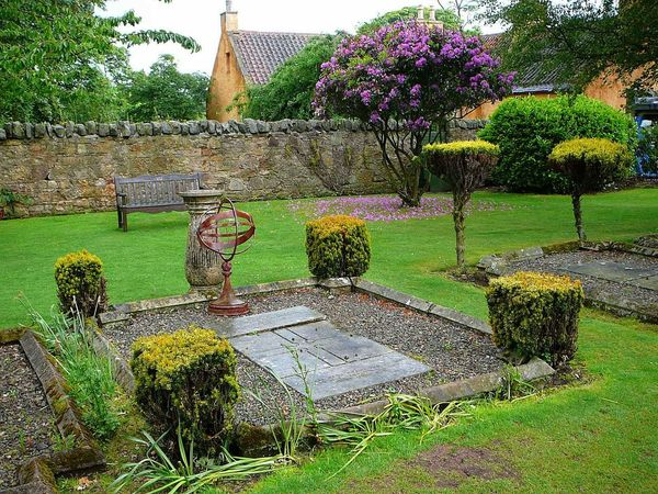 Serenity At Rest ~ Architecture Beauty In Nature Building Exterior Chapel Church Day Flower Grass Grave Graveyard Holy Lilac Tree Nature No People Outdoors Peaceful Plant Roslin Rosslyn Chapel Sacred Scotland Sky Stone Wall Sundial Tree