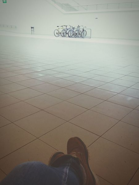 Hanging Out Taking Photos Check This Out Relaxing Enjoying Life EyeEm Best Shots Floortrait EyeEm Gallery Geometric Shape The Street Photographer – 2016 EyeEm Awards Relaxing Waiting For The Train From My Point Of View Jeans Boots Brown Boots Floortraits Sitting On A Bench Detail Bicycle Bycicles Parking Arrangement White Background CyclingUnites