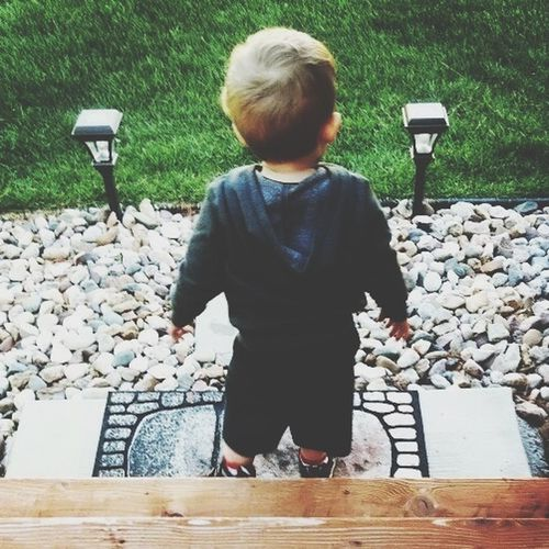 Symmetry One Person Childhood Boys Day Real People Casual Clothing Leisure Activity Rear View Full Length Outdoors Standing One Boy Only Child