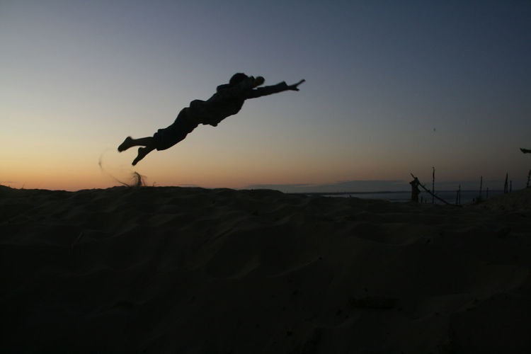 Superhero Beauty In Nature Clear Sky Dune Dune Du Pyla Dune Du Pilat Energetic Flying Full Length Leisure Activity Men Mid-air Nature One Person Outdoors People Real People Silhouette Sky Sunset Superman EyeEmNewHere The Week On EyeEm