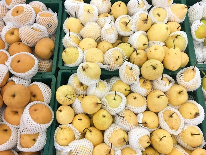 fresh Pyrus pyrifolia fruit in market Pyrus Pyrifolia Chinese Pear Close-up Food Food And Drink Freshness Fruit Healthy Eating Indoors  Large Group Of Objects Market Pear Sweet