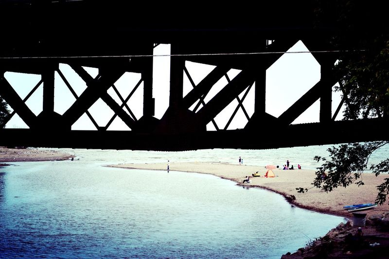 With @juliaharris and @eye4invisible way back in the summer. Water Bridge - Man Made Structure Silhouette Sky Architecture Built Structure Railroad Bridge Underneath Shore Sandy Beach Horizon Over Water Beach Engineering