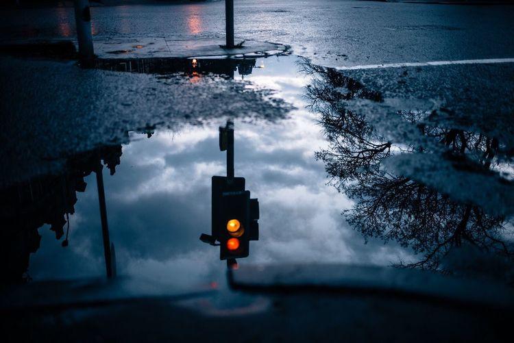 Water No People Red Light Outdoors Nature Illuminated Tranquility Rain Puddle reflection Urban Landscape stoplight Rainy