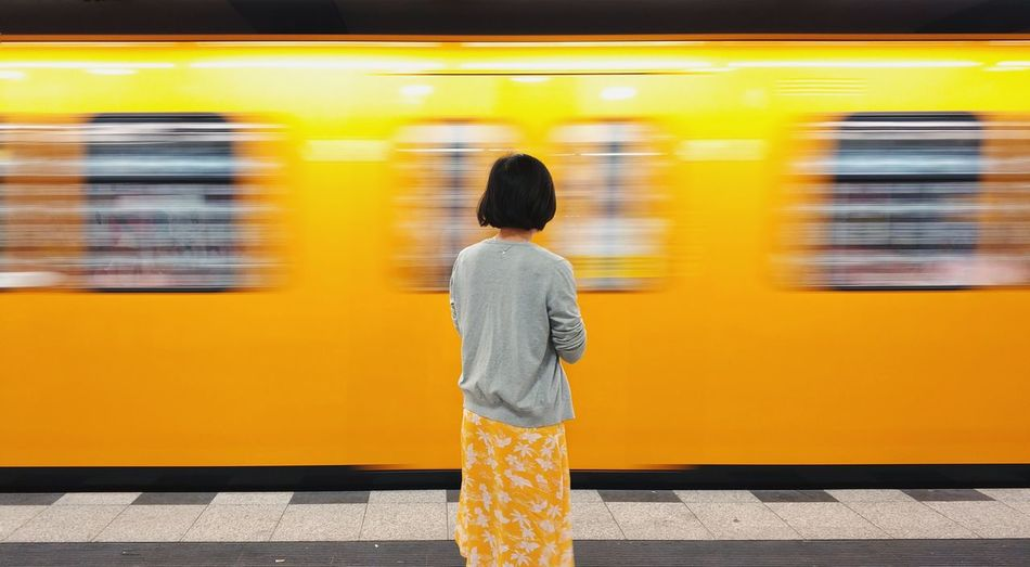 the girl in yellow dress Girl Backview Handyphoto Xiaomi Xiaomiphotography City Subway Train Subway Station Yellow Women Motion Standing Public Transportation Train - Vehicle Subway Platform Moving Past Subway Metro Train Underground Walkway